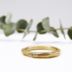 Yellow gold and diamond faceted ring