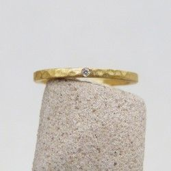 Yellow gold hammered wedding ring with diamond